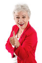 Elderly woman thumbs up stock photo happy senior with isolated on white with a red jacket Stock Photos