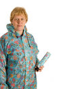 Elderly woman with umbrella Stock Images