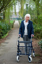 Elderly woman with walker Stock Images