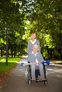 Elderly woman in wheelchair on Royalty Free Stock Image