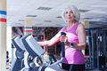 Elderly woman working out at gym