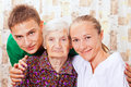 Elderly woman with the young doctors Stock Photography