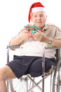 Eldery man in wheelchair celebrating christmas ver Royalty Free Stock Photo