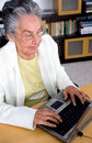 Eldery woman on a laptop Royalty Free Stock Photos