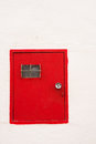 Electic meter door red for an electric on a whitewashed wall Stock Photos