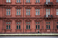 Electoral palace mainz germany june a tourist with a green vest and hiking clothes goes along the eastern facade of the on Stock Image