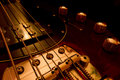 Electric bass guitar close up zoom on the bridge and buttons of an Royalty Free Stock Photography