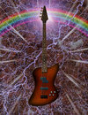 Electric bass guitar with rainbow Stock Image