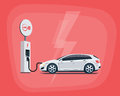 Electric Car Charging at the Charging Station on red background