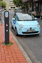 Electric car charging station dortmund germany july is being charged on july in dortmund germany germany announced it aims to have Royalty Free Stock Photo