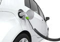 Electric car in charging station on white background Royalty Free Stock Photo