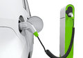 Electric car in charging station on white background Stock Photos