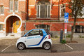 Electric car charging on street in Amsterdam. Netherlands. Royalty Free Stock Photo