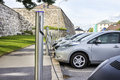 Electric car plugged in to electricity cars using free recharging station Stock Photography