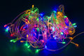 Electric christmas lights, festive garland Royalty Free Stock Photos