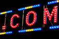 Electric .COM sign on a scaffolding in the night Royalty Free Stock Photo