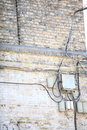 Electric controller box and tangle of cables on brick wall wires the Royalty Free Stock Photo