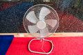 Electric fan on the floor. Royalty Free Stock Photo