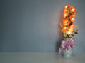 Electric flower in vase on table Royalty Free Stock Photo