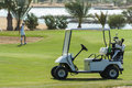 Electric golf buggy on a fairway Royalty Free Stock Photo