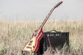 Electric guitar and amp on the field, the concept of music Royalty Free Stock Photo
