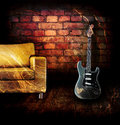 Electric guitar in the room with coach Royalty Free Stock Images