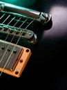 Electric guitar strings and bridge closeup macro abstract photo of the pickup of an shallow depth of field with focus across the Stock Images