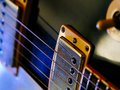 Electric guitar strings and pickups macro abstract photo of the of an shallow depth of field with focus on the first string Royalty Free Stock Photos