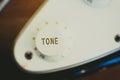 Electric guitar tone knob detail, music symbol
