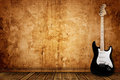 Electric guitar and the wall Royalty Free Stock Photo