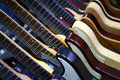 Electric guitars horizontal view of several lined up in a row Stock Photos
