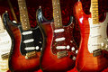 Electric guitars a row of guitar on display with red velvet backrground Stock Photography