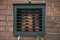 Electric heater on the brick wall Stock Photo