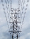 Electric high transmission under cloud and sky Stock Photo