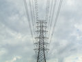 Electric high transmission under cloud and sky Royalty Free Stock Photos