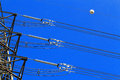 Electric high voltage pillar closeup of insulators sky background Stock Image