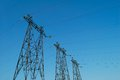 Electric high voltage power post over blue sky Stock Photo