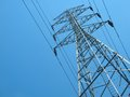 Electric high voltage transmission tower with blue sky Stock Image