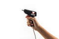 Electric hot glue gun holding on hand Royalty Free Stock Photography