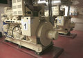 Electric Industrial generator inside power plant Royalty Free Stock Photo
