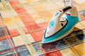 Electric iron for Ironing. Ironing room. Household items Royalty Free Stock Photo