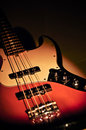 Electric jazz bass on a dramatic light Royalty Free Stock Photo
