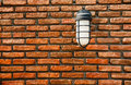 Electric lamp on wall old brick Royalty Free Stock Image