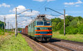 Electric locomotive hauling a cargo train Royalty Free Stock Photo
