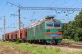 Electric locomotive hauling a grain train Royalty Free Stock Photo