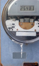 Electric meter, closeup, on outside wall Royalty Free Stock Photo