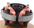Electric motor on board close up copper coil and magnets Royalty Free Stock Photo