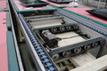 Electric motor and conveyor belt in factory