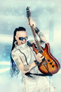 Electric music modern rock musician posing with his guitar futuristic style Royalty Free Stock Images