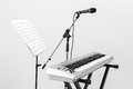 Electric piano microphone and music stand with sheet Royalty Free Stock Photo